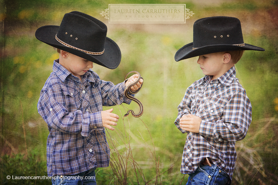 Two boys with a garter snake
