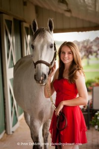Megan with her horse in her red prom dress